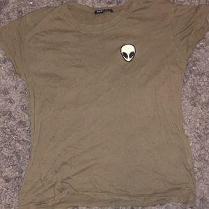 green tshirt with alien patch